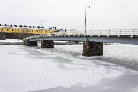Helsinki, Finland. Views of the frozen waters that surround the old town in a cold winter day, covered in ice and snow