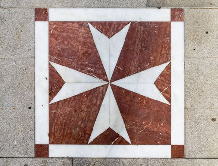 Lora del Rio, Spain. Mosaic in the floor with St John's Cross, emblem of the Sovereign Military Order of Malta, in this town in Andalucia Stock Photo