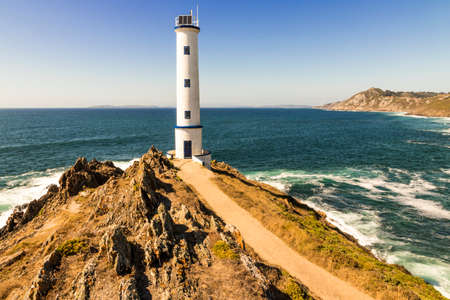 Cangas, Spain. The Faro de Cabo Home (Cape Home Lighthouse), in Galicia during a beautiful summer day