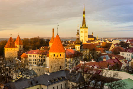 Tallinn, Estonia. Aerial view at sunset of the Old Town with the Church of St Olaf and the towers.