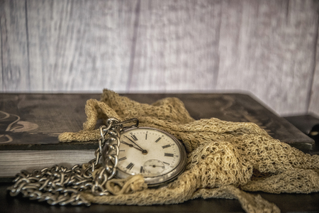 An Old Pocket Watch and Lace Gloves Stock Photo