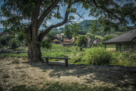 A small bench overlooking the beautiful scenery in the small town of Kosjeric in Serbia
