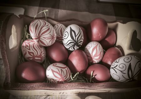 A box full of Easter eggs with hand drawn flowers (drawn by myself)