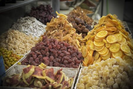 Colorful assortment of dried fruit on a market stall