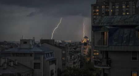 Night view of Belgrade with Temple of st Sava and lightning on the sky