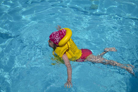 girl in swimming pool photo