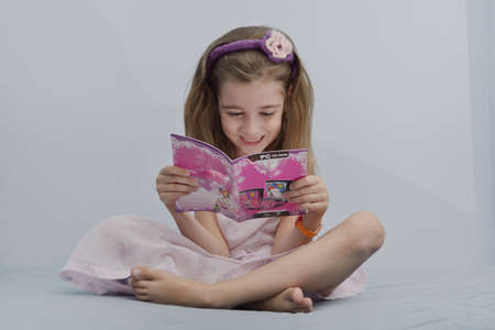 little girl read book photo
