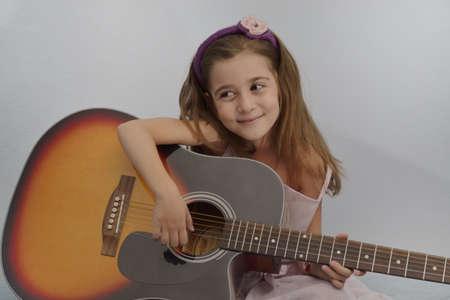 gitar: little girl play gitar Stock Photo