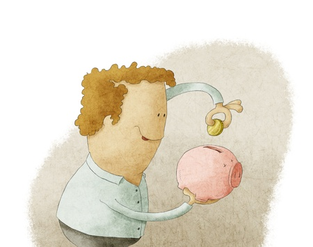 Young man putting coin into a piggy bank photo