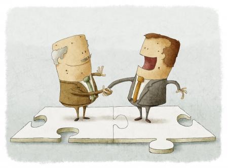 Dos hombres de negocios en un rompecabezas hacen un apretón de manos Foto de archivo - 24568668