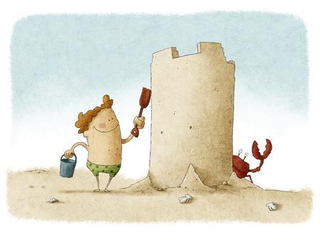 Jongen bouwt groot zandkasteel Stockfoto