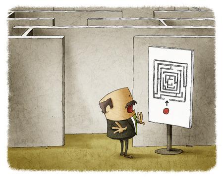 Zakenman en labyrint Stockfoto