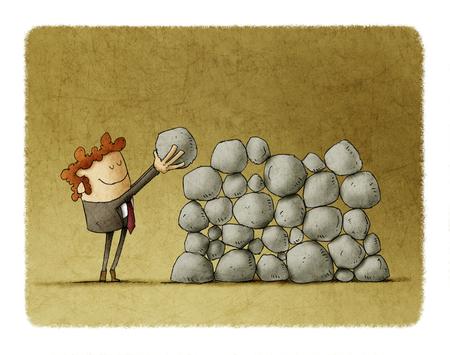 Zakenman zet een steen bovenop anderen, metafoor van inspanning en succes in het bedrijfsleven. Stockfoto