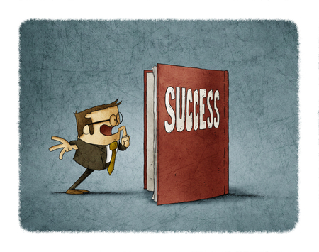 businessman is amazed to see the inside of a book about success Foto de archivo
