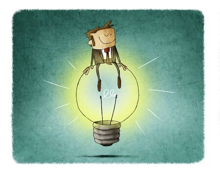 Cheerful man sitting on top of a big light bulb. idea and creativity concept. Imagens