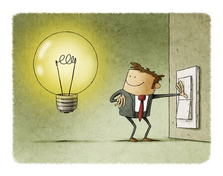 Businessman presses a switch and turns on a light bulb symbol of having an idea. Stockfoto