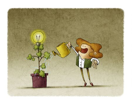 businesswoman is watering a plant from which a light bulb blooms. Stockfoto