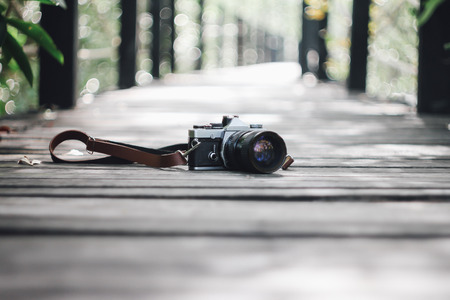 photographing: Camera on wood bridge