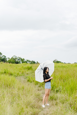 a Women with white umbrella