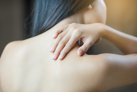 Shoulder pain women Stock Photo