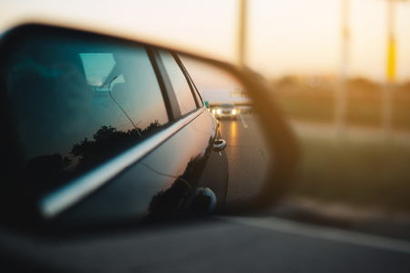 Car mirror with sunset Stock Photo