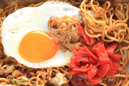 Japanese cuisine, fried noodles with sunny side up egg Stock Photo