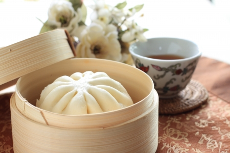 chinese cuisine: chinese Dimsum, steamed bun in bamboo steamer Stock Photo