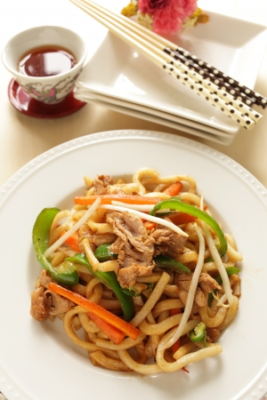 chinese cuisine, shanghai fried noodles with tea Stock Photo