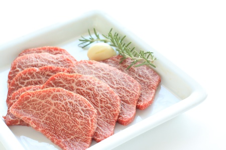 freshness Japanese beef for korean BBQ with garlic and herb on background photo