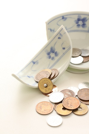 broken rice bowl and japanese coins photo