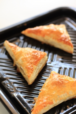 meat pie: meat pie in triangle shape on baking plate