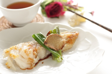 chinese cuisine, fried codfish with leek and ginger photo