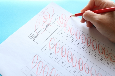 multiple choice: Red pen and Multiple choice answer shoot for education image