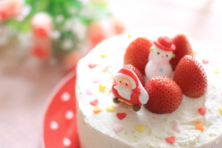 Home bakery Christmas cake with strawberry on top Stock Photo