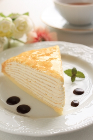 high tea: Gourmet dessert, milk crepe with black tea for high tea image Stock Photo