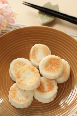 ange: japanese cuisine, fried kamaboko on dish with flower Stock Photo