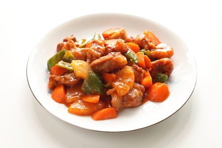 chinese cuisine, sweet and sour spareribs stir fried on white background