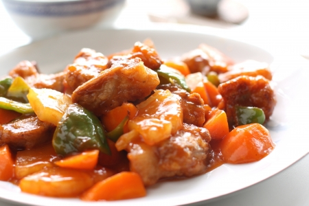 中華料理、野菜と甘い酸っぱいスペアリブ 写真素材