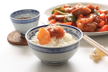 chinese cuisine, sweet   sour spareribs with vegetable on rice