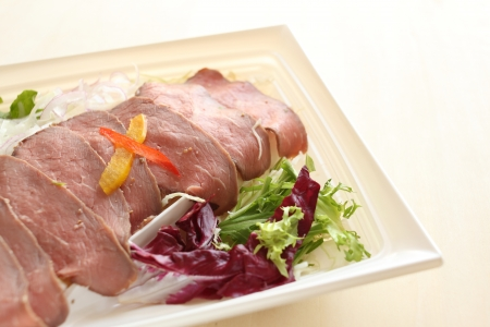 take out: close of of roasted beef on plastic food tray for take out food image Stock Photo