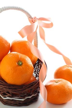fruit basket: mandarin orange in fruit basket with ribbon
