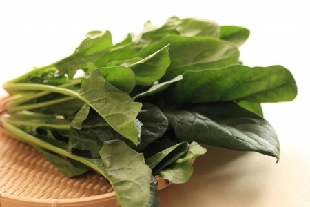 spinach on bamboo basket for food ingredient image