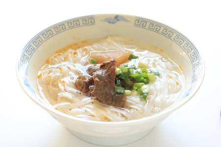 chinese cuisine, simmered beef tendon on Rice noodles photo