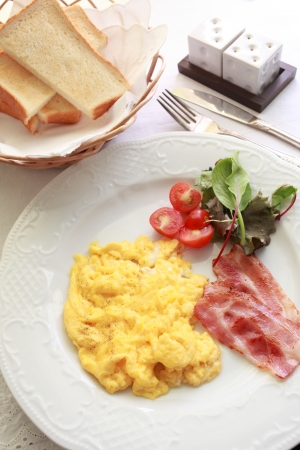 gourmet breakfast, scrambled egg and bacon photo