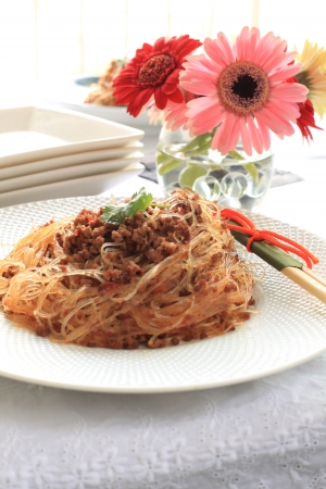 asian food, gelatin noodles and mince beef stir fried with spicy sauce photo
