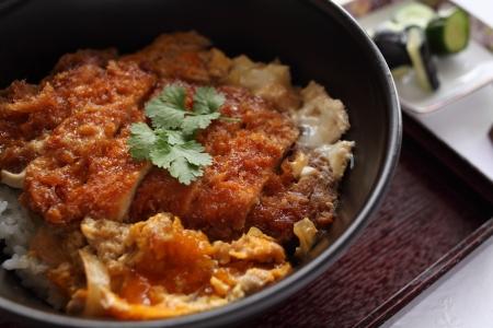 breadcrumbs: japanese cuisine, Tonkatsu Don Cutlet rice Stock Photo
