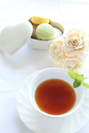 Mint tea and mararon for afternoon tea image photo