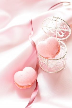 Pink heart shaped macaron on silk for wedding image Stock Photo - 21023128