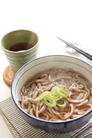 soba noodles: Japanese food, soba noodles with hot tea on background