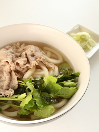 Japanese food, pork and parsley on Udon noodles photo